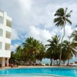Swimming pool and beach at the popular hotel, Bentota, Sri Lanka - Stock Photo