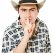 Cowboy shows the silence on white background. — Foto de Stock