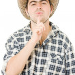 Cowboy blows on his finger. — Stock Photo #6819713