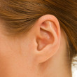 Ear women as part of the body. — Stock Photo #6820212