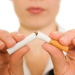 Woman breaks down the cigarette. — Stock Photo #6820312