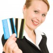 Businesswoman with a debit cards on a white background. — Stock Photo #6820362