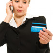 Businesswoman with a debit card on a white background. — Stock Photo #6820375