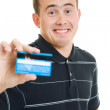 Man with a debit card on a white background. — Stock Photo #6820657