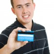 Man with a debit card on a white background. — Stock Photo