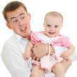A young father with a baby on a white background. — Stock Photo #6820852