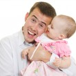 A young father with a baby on a white background. — Stock Photo