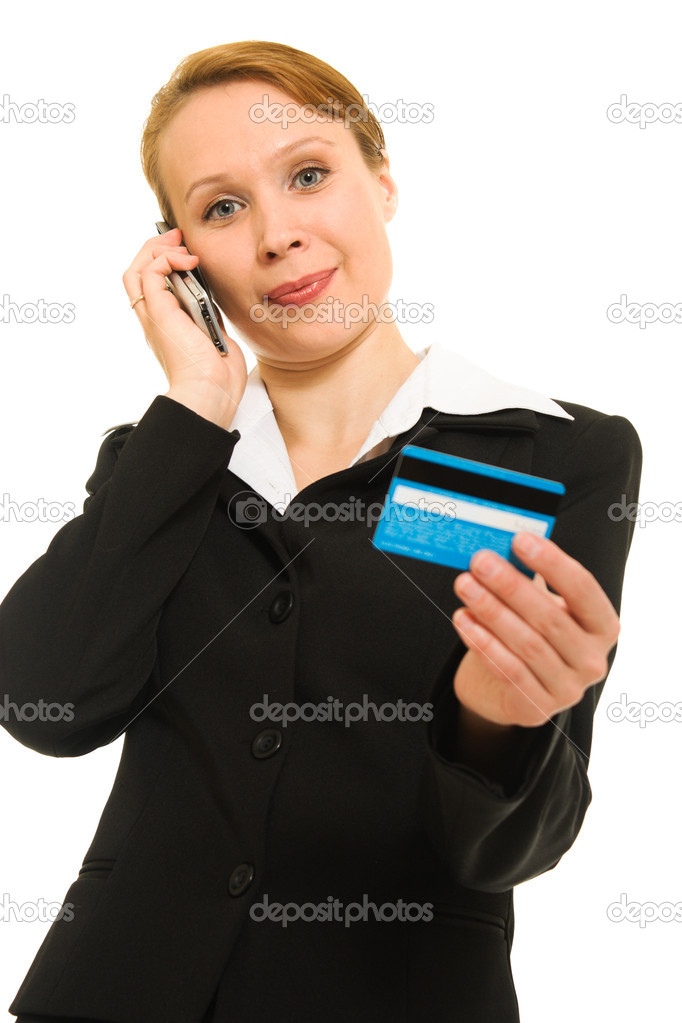 Businesswoman with a debit card and a mobile phone on a white background.  Stock Photo #6820390