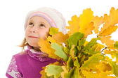 Girl with a bouquet of oak leaves on a white background. — Stock Photo