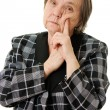 Thinking old lady on a white background. — Stock Photo