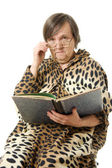 The old woman is reading a book on a white background — Stock Photo