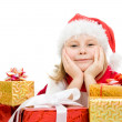 Happy Christmas child with gifts in the boxes on a white background. — Stock Photo #7486644