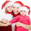 Stock Photo: Happy Christmas woman with children on a white background.