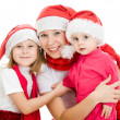 Happy Christmas woman with children on a white background. — Stock Photo