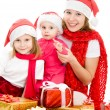 Happy Christmas woman with children on a white background. — Stock Photo #7486679