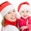 Happy Christmas mother and daughter on a white background. — Stock Photo #7486769