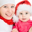 Happy Christmas mother and daughter on a white background. — Stock Photo #7486778