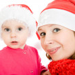 Happy Christmas mother and daughter on a white background. — Stock Photo #7486799