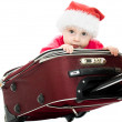 Christmas baby in the suitcase on a white background. — Stock Photo