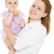 The woman gives the baby a bottle of infant formula. — Stock Photo