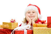 Happy Christmas child with gifts in the boxes on a white background. — Stock Photo