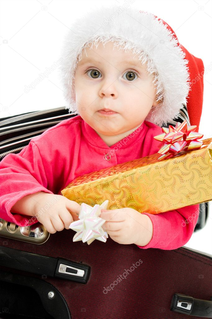 Christmas baby in the suitcase on a white background. — Stock Photo #7486821