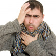 Sick man wearing a scarf on a white background. — Stock Photo