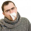 A patient man with a runny nose. — Stock Photo