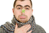 A patient man with a stuffy nose on a white background. — Stock Photo