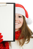 Happy Christmas woman with tablet in hand on white background. — Stock Photo