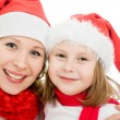 Happy Christmas mother and daughter on a white background. — Stock Photo #7616600