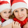 Happy Christmas mother and daughter on a white background. — Stock Photo #7616636