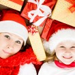 Happy Christmas mother and daughter with presents on a white background. — Stock Photo #7616717