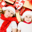 Happy Christmas mother and daughter with presents on a white background. — Stock Photo #7616721