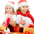 Royalty-Free Stock Photo: Happy Christmas mother and daughter with presents on a white background.