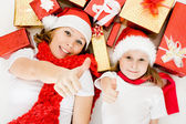 Happy Christmas mother and daughter with presents on a white background. — Stock Photo