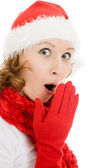 Surprised Christmas woman on a white background. — Stock Photo