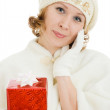 Woman with Christmas presents on a white background. — Stock Photo