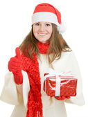 Happy Christmas woman points a finger upward on a white background. — Foto Stock