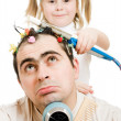 Daughter of braids cornrows his father on a white background. — Stock Photo