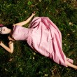 Stock Photo: Girl lie on grass like corpse