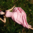 Girl lie on the grass like a corpse — Stock Photo