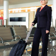 Businesswoman with luggage - Foto de Stock