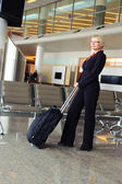Businesswoman with luggage — Stock Photo