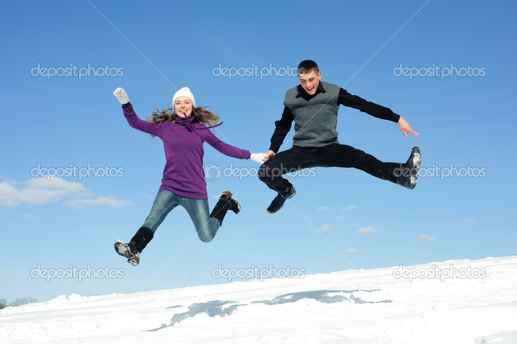 Jumping pair isolated snow field and blue sky — Stock Photo #6898763
