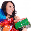 Young woman in red christmas clothing with a lot of present box — Stock Photo