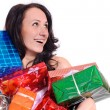 Young woman in red christmas clothing with a lot of present box — Stock Photo #6907437