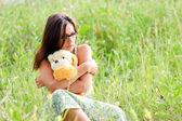 žena s hračkou — Stock fotografie