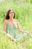 Woman sit and meditate in the park — Stock Photo