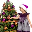 Pretty girl with present near the Cristmas tree — Stock Photo #7675828